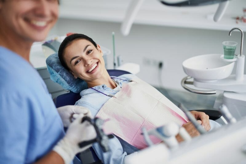 Young woman smiling while at the dentist