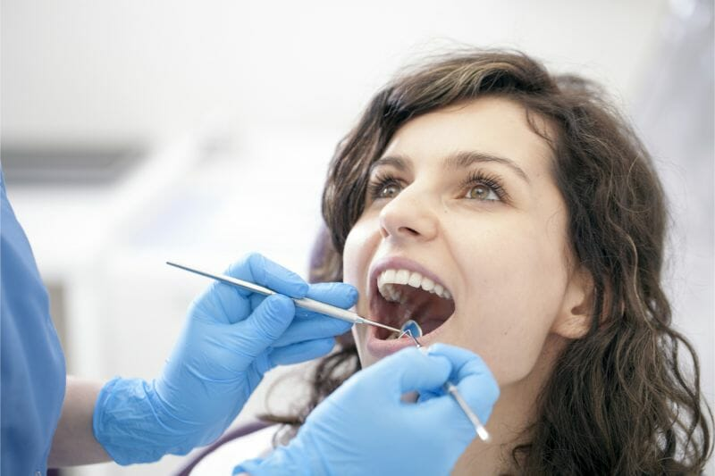young woman getting dental cleaning