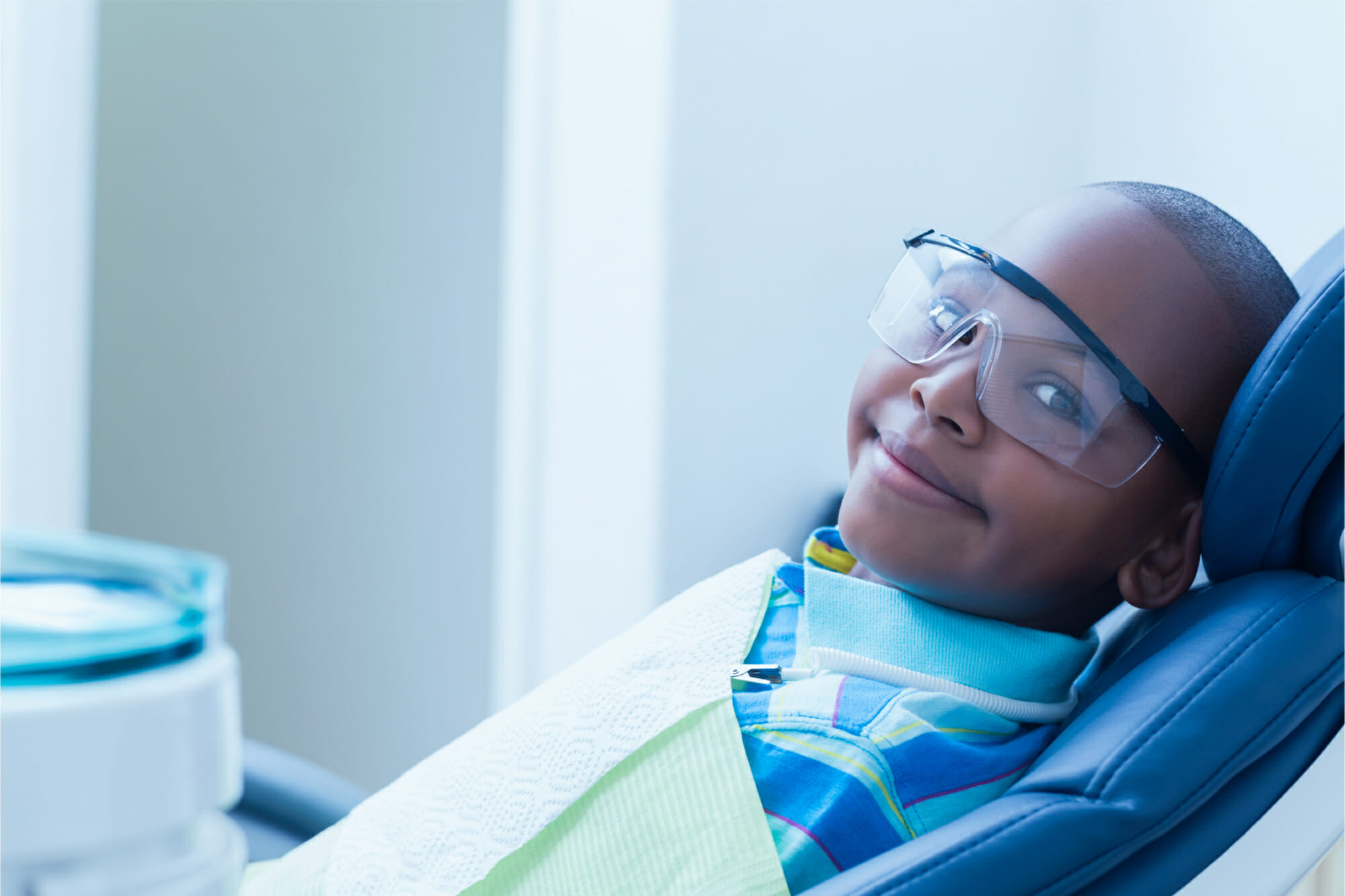 young child at the dentist smiling