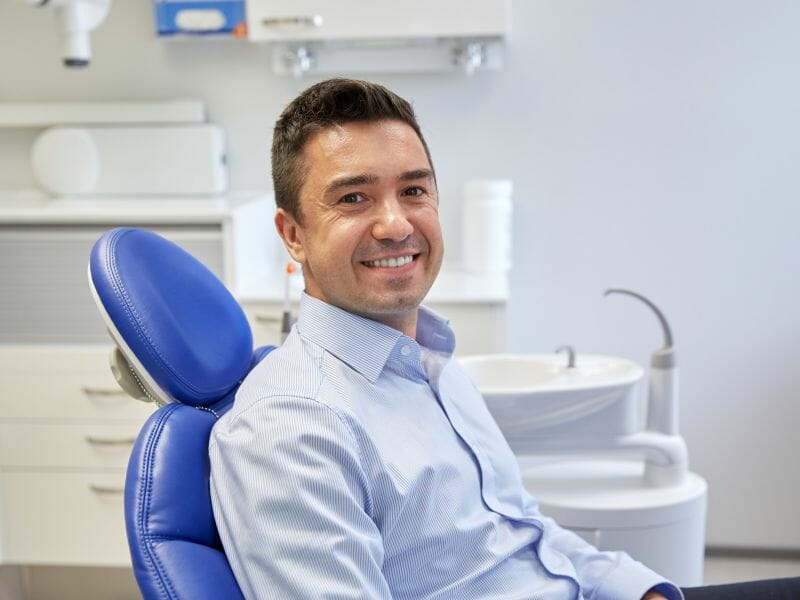 man sitting in dentist chair for exam